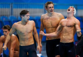 Members of France's 4x100m men's freestyle relay team Clement Lefert, Fabien Gilot and Amaury Leveaux cheer as their anchor Yannick Agnel swims to win the event final at the London 2012 Olympic Games at the Aquatics Centre July 29, 2012. France avenged their defeat to the United States in Beijing four years ago when they snatched the gold medal in the men's 4x100 metres freestyle final at the London Olympics on Sunday. REUTERS/Jorge Silva (BRITAIN - Tags: SWIMMING SPORT OLYMPICS) ORG XMIT: OLYDN460